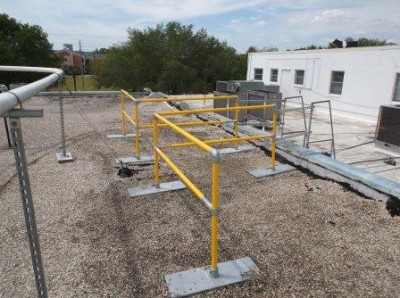 Non-penetrating rooftop ladder access guardrail
