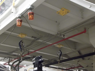 Single point anchors for industrial machinery maintenance attached to a mezzanine platform